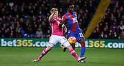 Pape Souare looks to beat Matt Ritchie during the Barclays Premier League match between Crystal Palace and Bournemouth at Selhurst Park, London, England on 2 February 2016. Photo by Michael Hulf.