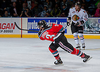 KELOWNA, CANADA - OCTOBER 5:  Riley Stadel #3 of the Kelowna Rockets takes a shot on net against the Portland Winterhawks  at the Kelowna Rockets on October 5, 2013 at Prospera Place in Kelowna, British Columbia, Canada (Photo by Marissa Baecker/Shoot the Breeze) *** Local Caption ***