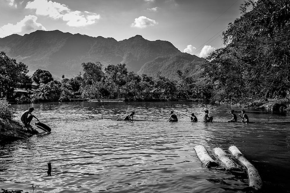 Children play in small lake in Mai <br /> Chau, northern Vietnam.