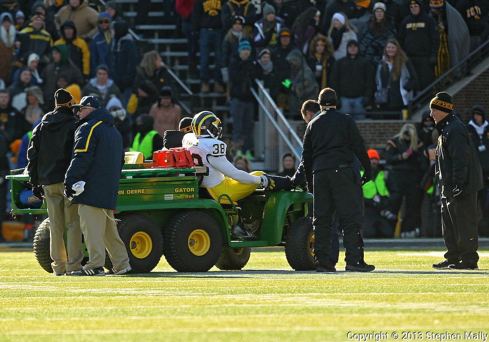 November 23 2013: Michigan Wolverines running back Thomas Rawls (38) is carted off the field during the first quarter of the NCAA football game between the Michigan Wolverines and the Iowa Hawkeyes at Kinnick Stadium in Iowa City, Iowa on November 23, 2013. Iowa defeated Michigan 24-21.