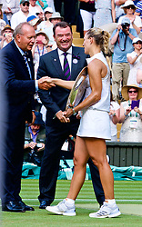 LONDON, ENGLAND - Saturday, July 14, 2018: Angelique Kerber (GER) receives Venus Rosewater Dish trophy as she celebrates winning the Ladies' Singles Final match 6-3, 6-3 on day twelve of the Wimbledon Lawn Tennis Championships at the All England Lawn Tennis and Croquet Club. (Pic by Kirsten Holst/Propaganda)