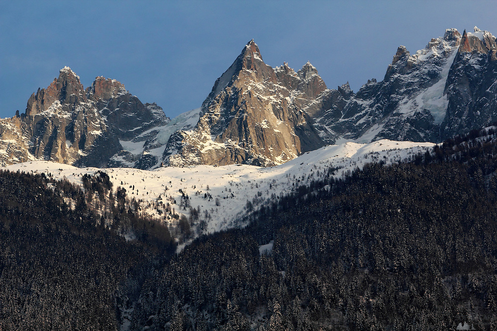 Views of the peaks surrounding Chamonix in the French Alps, taken from the town, on a sunny and very cold afternoon in February.