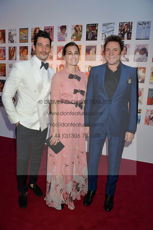 Left to right, DAVID GANDY and SIMON & YASMIN LE BON at British Vogue's Centenary Gala Dinner in Kensington Gardens, London on 23rd May 2016.