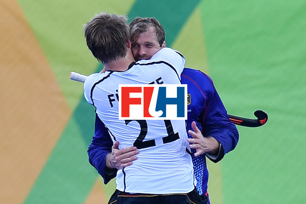 Germany's Moritz Furste celebrates with Germany's Nicolas Jacobi after the mens's field hockey Germany vs Netherlands match of the Rio 2016 Olympics Games at the Olympic Hockey Centre in Rio de Janeiro on August, 12 2016. / AFP / MANAN VATSYAYANA        (Photo credit should read MANAN VATSYAYANA/AFP/Getty Images)
