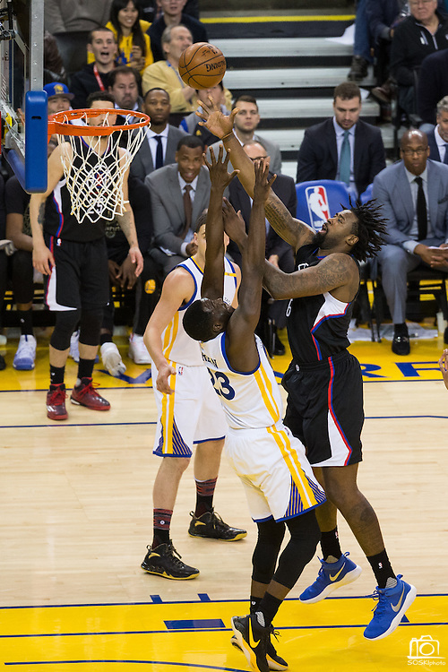 LA Clippers center DeAndre Jordan (6) takes the ball to the basket over Golden State Warriors forward Draymond Green (23) at Oracle Arena in Oakland, Calif., on February 23, 2017. (Stan Olszewski/Special to S.F. Examiner)