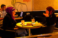 Palestinian Arab women having a coffee in a cafe, Jerusalem, Israel.