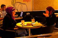 Palestinian Arab women having a coffee in a cafe, Jerusalem, Israel.