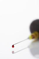 Blood droplet on syringe close-up