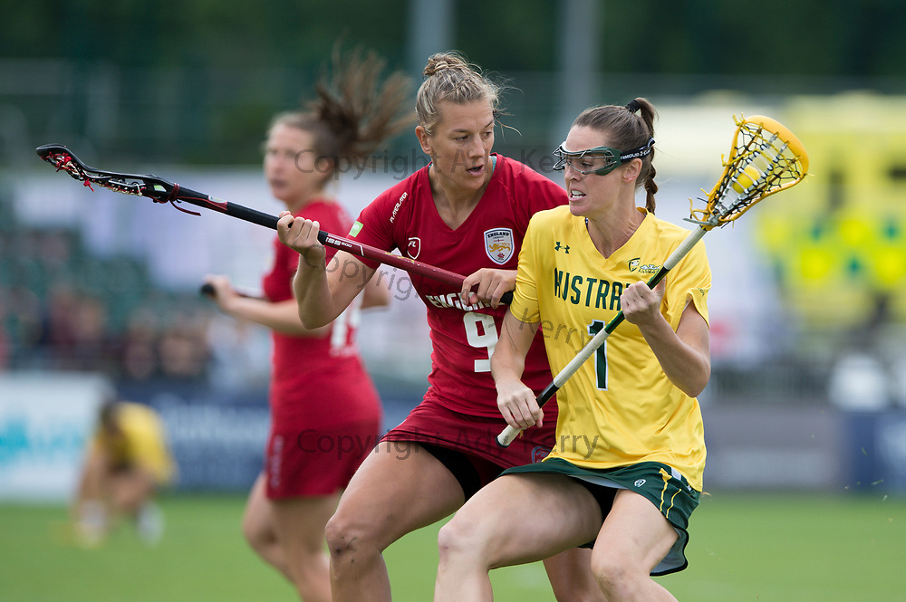 England's Laura Merrified challenges with Australia's Abbie Burgess in the bronze medal match which they won with a Golden Goal in extra time at the 2017 FIL Rathbones Women's Lacrosse World Cup, at Surrey Sports Park, Guildford, Surrey, UK, 22nd July 2017.