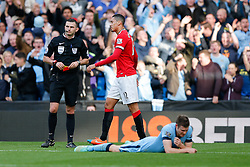 Chris Smalling of Manchester United looks dejected after being shown a red card by referee Michael Oliver after a challenge on James Milner of Manchester City - Photo mandatory by-line: Rogan Thomson/JMP - 07966 386802 - 02/11/2014 - SPORT - FOOTBALL - Manchester, England - Etihad Stadium - Manchester City v Manchester United - Barclays Premier League.