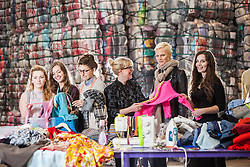 Students Emam McDowall, Lucu Morrant, Hannah McKinnon, Scottish fashion designer Niki Taylor, Model Anna Freemantle, and student Allison Radcliffe. Showing fashion students about upcycling clothes, at the UK&rsquo;s second largest textile recycling facility, Nathan&rsquo;s Wastesavers, in Denny.<br /> &copy; Michael Schofield.