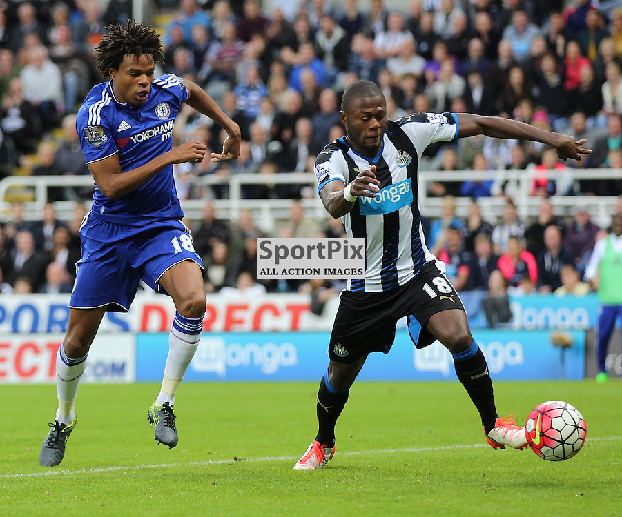 Newcastle United v Chelsea English Premiership 26 September 2015; Loic Remy (Chelsea, 18) is stopped by Chancel Mbemba (Newcastle, 18) during the Newcastle v Chelsea English Premiership match played at St. James' Park, Newcastle; <br /> <br /> &copy; Chris McCluskie | SportPix.org.uk