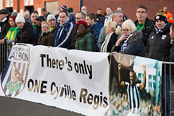© Licensed to London News Pictures. 30/01/2018. The funeral of footballer Cyrille Regis took place in West Bromwich today. The hearse made it's way past the football ground where he played as family, friends and fans said their final farewell. Pictured, fans outside the Hawthorns. Photo credit: Dave Warren/LNP