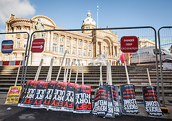 © Licensed to London News Pictures. 02/10/2016. Birmingham, UK. Placards await a national demonstration against the policies of Britain's Conservative government in Victoria Square. The Conservative Party conference begins today at the ICC in Birmingham and is the first under the leadership of Prime Minister Theresa May, who took over after David Cameron's resignation in July 2016. Photo credit: Rob Pinney/LNP