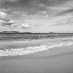 Big Beach Maui Hawaii black and white photo with Molokini Crater and Kaho'olawe Island Reserve. Big Beach is in Wailea-Makena Hawaii and is one of Maui's most popular beaches. Copyright ⓒ 2019 Paul Velgos with All Rights Reserved.