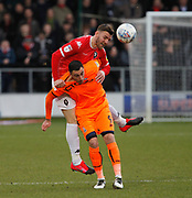 Lee Novak of Bradford City in action with Salford City's Liam Hogan(5) during the EFL Sky Bet League 2 match between Salford City and Bradford City at the Peninsula Stadium, Salford, United Kingdom on 7 March 2020.