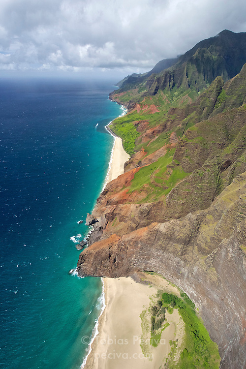 Aerial view of deserted beaches along the Na Pali coastline, on Kauai, Hawaii.