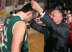 Mirza Begic of Union Olimpija get a gold medal from Dusan Sesok, president of Basketball federation of Slovenia after the final match of Spar Cup 2007-08 between Union Olimpija, Ljubljana, Slovenia, and Helios Domzale, Slovenia, on February 10, 2008, in Arena Kodeljevo, Ljubljana, Slovenia. Match and Cup was won by Union Olimpija, who defeated Helios Domzale in final match with 85:66. (Photo by Vid Ponikvar / Sportal Images).