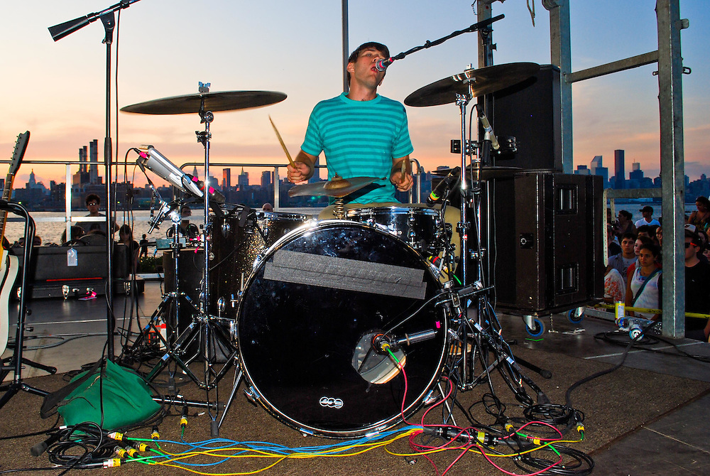 Christopher Bear of Grizzly Bear on drums at the JELLY Pool Party free concert series East River State Park, Williamsburg, Brooklyn, New York