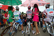 Contador, now in pink, gets to enjoy sun protection from the pink podium girl for a few minutes at the start of each stage.