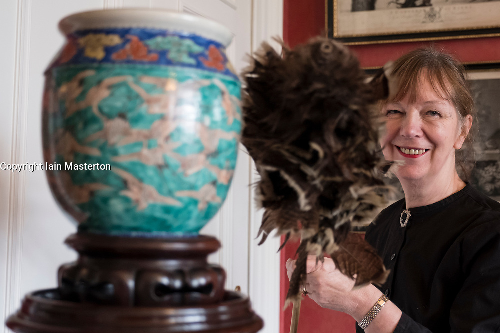 Edinburgh, Scotland, United Kingdom . 27th February, 2018. Volunteers wearing Edwardian costumes prepare to give Lauriston Castle in Edinburgh a Spring clean in preparation for the public opening later in the year. Pictured, Hilary Lovie cleans vase with feather duster.