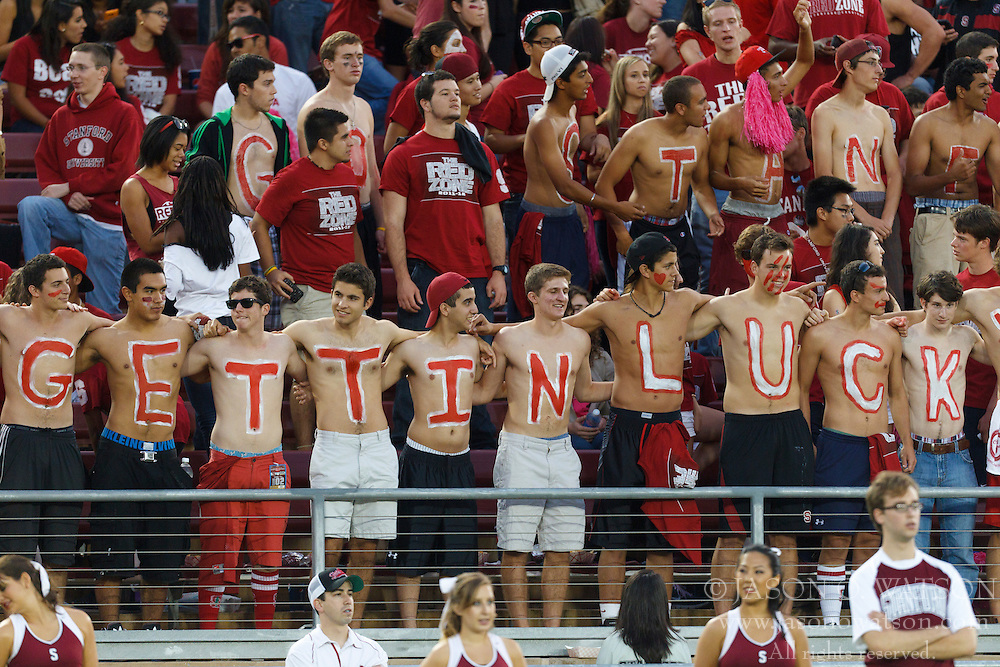 Oct 1, 2011; Stanford CA, USA;  Stanford Cardinal students paint their chests in support of quarterback Andrew Luck (not pictured) before the game against the UCLA Bruins at Stanford Stadium. Stanford defeated UCLA 45-19. Mandatory Credit: Jason O. Watson-US PRESSWIRE