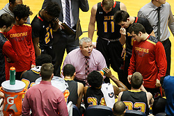 Dec 16, 2017; Morgantown, WV, USA; Wheeling Jesuit Cardinals head coach Danny Sancomb talks to his team during a timeout during the first half against the West Virginia Mountaineers at WVU Coliseum. Mandatory Credit: Ben Queen-USA TODAY Sports
