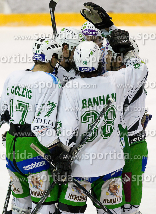 Tilia Olimpija celebrates at 28th Round  ice hockey match of EBEL league between HK Acroni Jesenice and HDD Tilia Olimpija Ljubljana, on December 4, 2009, in Arena Podmezaklja, Jesenice, Slovenia. Olimpija defeated Jesenice 8-7. (Photo by Vid Ponikvar / Sportida)