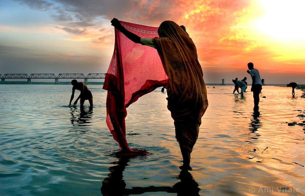 Hindus wash after making prayers to Lord Shiva at the river Saruj in the northern Indian city of Ayodhya.