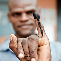 USE ARROWS &larr; &rarr; on your keyboard to navigate this slide-show<br /> <br /> Dar Es Salaam, Tanzania, 31 October 2010<br /> A Tanzanian citizen shows his ink marked finger after voting.<br /> The European Union has launched an Election Observation Mission in Tanzania to monitor the general elections, responding to the Tanzanian government invitation to send observers for all aspects of the electoral process.<br /> The EU sent this observation mission led by Chief Observer David Martin, a member of the European Parliament. <br /> Photo: Ezequiel Scagnetti