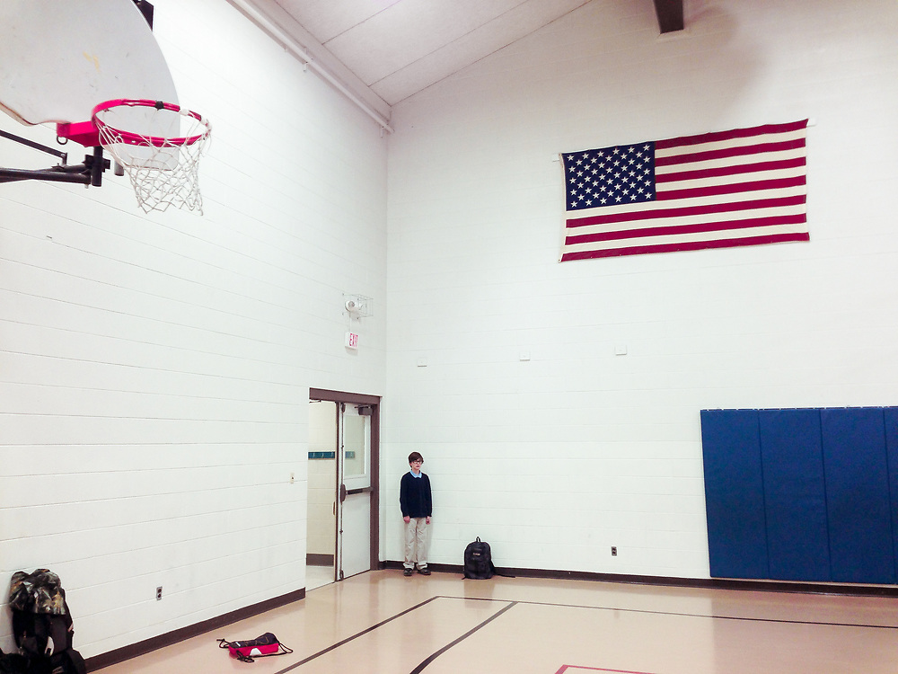 Student alone in the school gym at Bigfork Elementary School