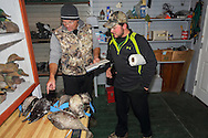 After the hunt, ducks are sorted, tallied, and tagged for transport in the decoy shack.