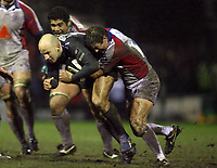 Photo: Rich Eaton.<br /> <br /> Sale Sharks v Bristol Rugby. Guinness Premiership. 01/01/2007. Daniel Larrechea left of Sale is stopped by a committed Bristol defence