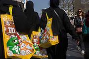 Muslim women in Islamic dress on a shopping trip in London's West End.