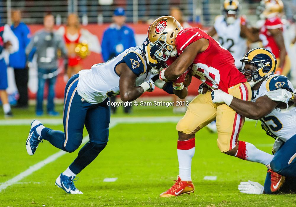 SEP 12,2016: San Francisco 49ers running back Carlos Hyde (28) tries to get passed the defensive line  during the regular season NFL  game between the San Francisco 49ers verses the Los Angeles Rams at Levi's Stadium in Santa Clara, CA. (Photo by Samuel Stringer/Icon Sportswire)