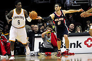 March 27, 2011; Cleveland, OH, USA; Atlanta Hawks guard Kirk Hinrich (6) nearly forces a turnover from Cleveland Cavaliers guard Manny Harris (6) during the fourth quarter at Quicken Loans Arena. The Hawks beat the Cavaliers 99-83. Mandatory Credit: Jason Miller-US PRESSWIRE