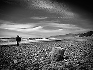 Black and White Photography of the Oregon Pacific Northwest coast. Man Walking on Beach