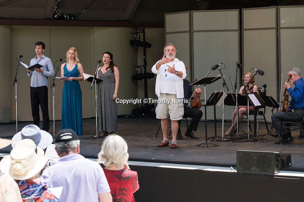 "Mark Morris conducts the American String Quartet, pianist Colin Fowler, trumpet player Sycil Mathai, soprano Yulia Van Doren, mezzo-soprano Jamie Van Eyck, bass-baritone Douglas Williams and the audience in Carl Ruggles' ""Exaltation"" at Libbey Bowl on June 9, 2013 in Ojai, California."