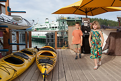 United States, Washington, San Juan Island, Friday Harbor. children and kayaks on dock at the Port of Friday Harbor.  MR
