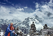 "On a 1981 trek in the Mount Everest area, Tom Dempsey pauses for a self portrait at 15,400 feet elevation on the terminal moraine of the Khumbu Glacier across from Taweche Peak, Nepal, Asia. A row of stone monuments were built near here in memory of six Sherpas who were killed in an avalanche during the 1970 Japanese expedition to film ""The Man Who Skied Down Everest."" Sagarmatha National Park is honored by UNESCO as a World Heritage Site."