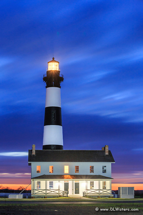 Bodie Island Lighthouse  as the first light of day breaks the horizon on the Outer Banks, NC.
