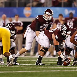 Jan 7, 2011; Arlington, TX, USA; Texas A&M Aggies quarterback Ryan Tannehill (17) under center during the second half of the 2011 Cotton Bowl against the LSU Tigers at Cowboys Stadium.  Mandatory Credit: Derick E. Hingle