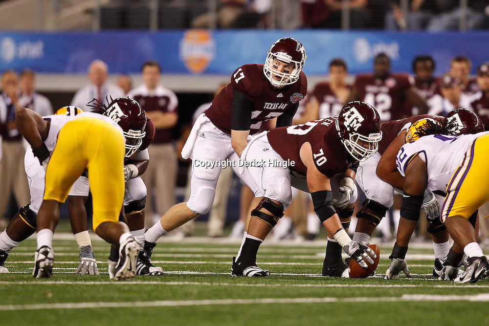 Jan 7, 2011; Arlington, TX, USA; Texas A&M Aggies quarterback Ryan Tannehill (17) under center during the second half of the 2011 Cotton Bowl against the LSU Tigers at Cowboys Stadium.  Mandatory Credit: Derick E. Hingle