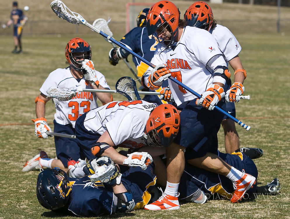 Virginia Cavaliers M Max Pomper (42) and Virginia Cavaliers D Chad Gaudet (7) pile on for a loose ball.  The #2 ranked Virginia Cavaliers defeated the Drexel Dragons 13-7 at the University of Virginia's Klockner Stadium in Charlottesville, VA on February 14, 2009.