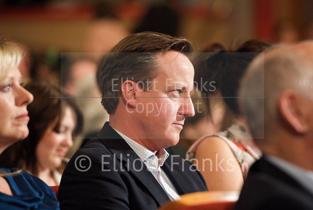 Conservative Party Conference, ICC, Birmingham, Great Britain <br /> Day 1<br /> 7th October 2012 <br /> <br /> <br /> David Cameron MP<br /> Prime Minister <br /> watching William Hague's Speech <br /> <br /> Photograph by Elliott Franks<br /> <br /> Tel 07802 537 220 <br /> elliott@elliottfranks.com<br /> <br /> &copy;2012 Elliott Franks<br /> Agency space rates apply