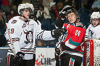 KELOWNA, CANADA - NOVEMBER 9:  Brooks Maxwell #19 of the Red Deer Rebels nudges Tyson Baillie #24 of the Kelowna Rockeets at the Kelowna Rockets on November 9, 2012 at Prospera Place in Kelowna, British Columbia, Canada (Photo by Marissa Baecker/Shoot the Breeze) *** Local Caption ***