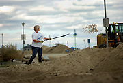 Mary Walsifer shovels out sand from her property on 11th Avenue & Ocean Avenue in Belmar two days after Hurricane Sandy made it's way through the area on October 31. Hurricane Sandy forced the shutdown of mass transit, schools and financial markets, sending coastal residents fleeing for higher ground, and threatened a dangerous mix of high winds and soaking rain.