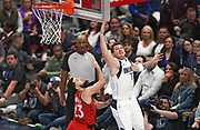 Dallas Mavericks point guard Luka Doncic (77) shoots over Toronto Raptors shooting guard Fred VanVleet (23) during an NBA basketball game, Saturday, Nov. 16, 2019, in Dallas. The Mavericks defeated the Raptors 110-102. (Wayne Gooden/Image of Sport)