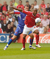 Photo: Leigh Quinnell.<br /> Nottingham Forest v Carlisle United. Coca Cola League 1. 16/09/2006. Forests Junior Agogo keeps the ball from Carlisles Peter Murphy.