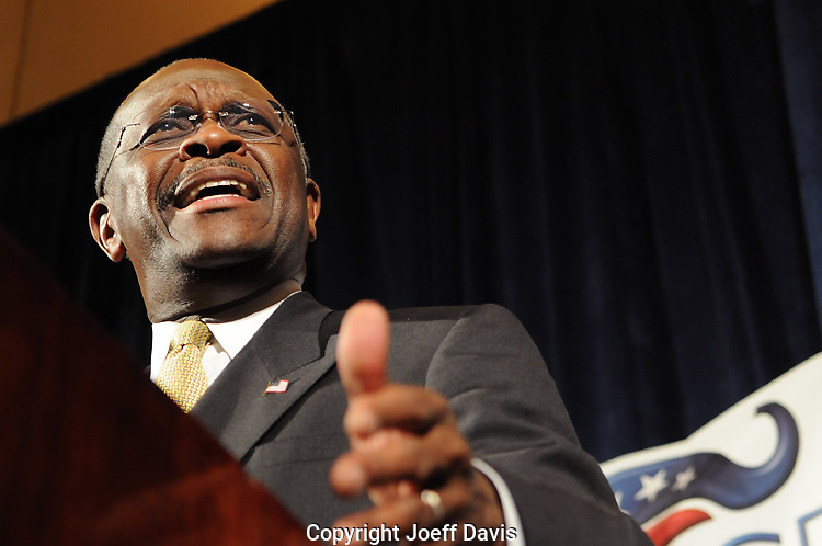 November 12, 2011 - Atlanta, Georgia: Republican presidential candidate Herman Cain visited Atlanta this morning to address the fall meeting of the Young Republican National Federation at the Westin Peachtree Plaza.<br /> <br /> Cain spoke for roughly 20 minutes to a crowd of about 200 people. The former talk radio host and pizza company CEO did not not mention four women's allegations that he sexually harassed them during his tenure at the National Restaurant Association more than ten years ago. Cain has denied all accusations.<br /> <br /> Cain took no questions from the media.